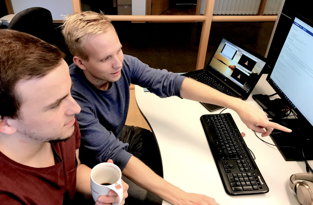 Two young men working at Data Respons